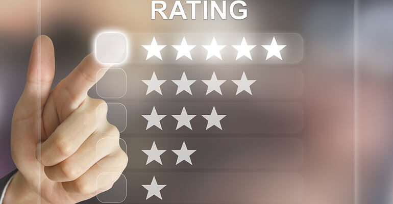 Hand pointing to star ratings to review