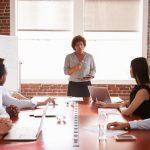 Woman leading board meeting