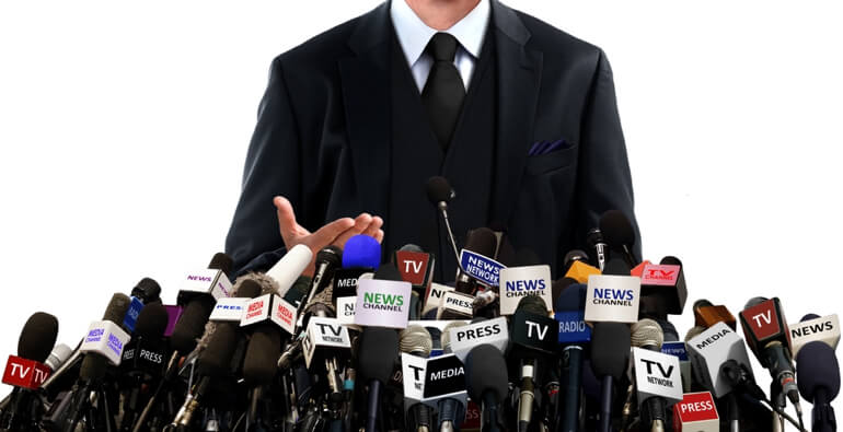 Man facing many press microphones