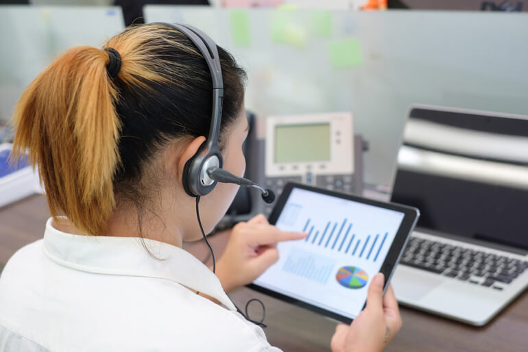 Call center worker looking at tablet