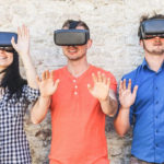 3 people using Virtual Reality headsets.