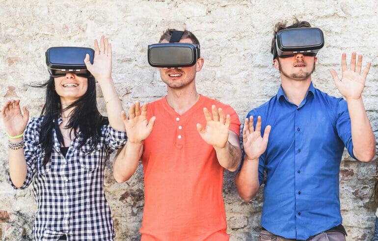3 people using Virtual Reality headsets.