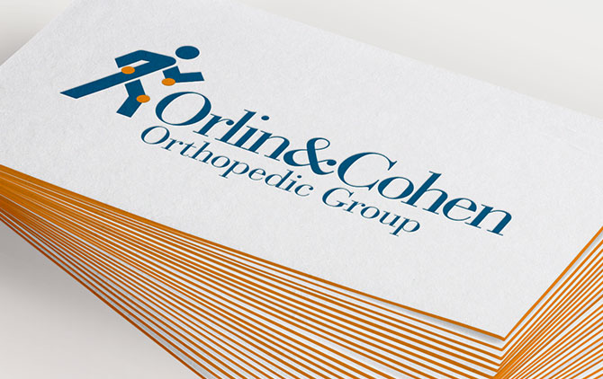 Orlin & Cohen logo on business cards