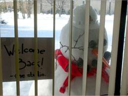 snowman outside of desk window